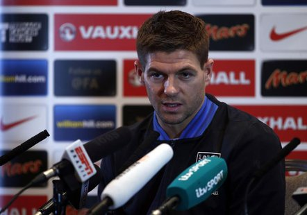 England captain Steven Gerrard attends a media conference at a hotel in London February 5, 2013. England are due to play a friendly soccer m