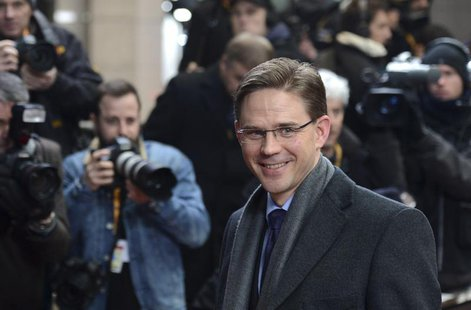 Finland's Prime Minister Jyrki Katainen arrives at the EU council headquarters for an European Union leaders summit meeting to discuss the E