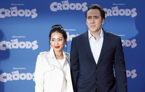 "Cast member Nicolas Cage and wife Alice Kim (L) arrive for the premiere of the film ""The Croods"" in New York, March 10, 2013. REUTERS/Carlo"