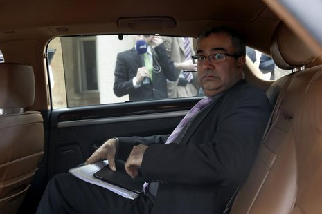 Cyprus Central Bank Governor Panicos Demetriades leaves the presidential palace in Nicosia March 21, 2013. REUTERS/Yorgos Karahalis