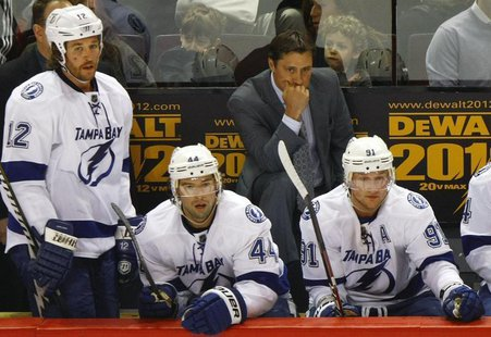 Tampa Bay Lightning head coach Guy Boucher reacts at the end of the second period of NHL hockey action in Montreal, April 4, 2012. REUTERS/O