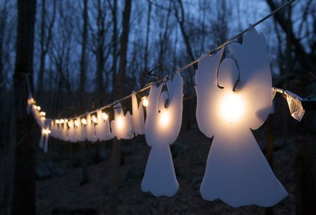 Lighted angels hang from a tree in Monroe, Connecticut January 14, 2013, on the one-month anniversary of the shooting at Sandy Hook elementa