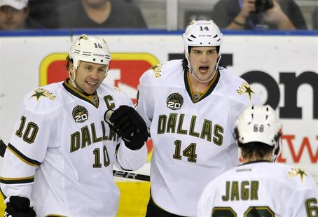 Dallas Stars' Brenden Morrow (L), Jamie Benn and Jaromir Jagr (R) celebrate a goal against the Edmonton Oilers during the second period of t