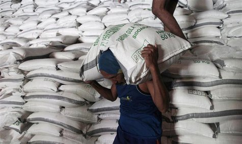 Workers load sacks of sugar from a warehouse onto a truck for distribution to the traders in Sidoarjo of Indonesia's East Java province Febr