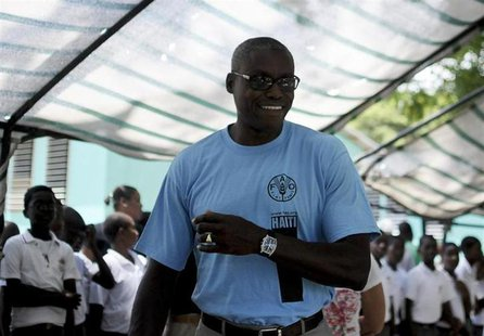 Carl Lewis (C), nine-time U.S. Olympic gold medalist and Goodwill Ambassador for the UN Food and Agriculture Organization (FAO), arrives at