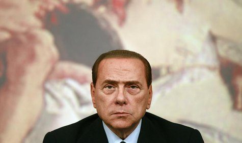 Former Italian prime minister Silvio Berlusconi looks on during a news conference at Chigi Palace in Rome August 4, 2011. REUTERS/Tony Genti