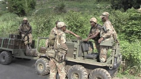 Armed South African soldiers talk in Begoua, 17 km (10 miles) from capital Bangui, in this still image taken from video, March 23, 2013. REU