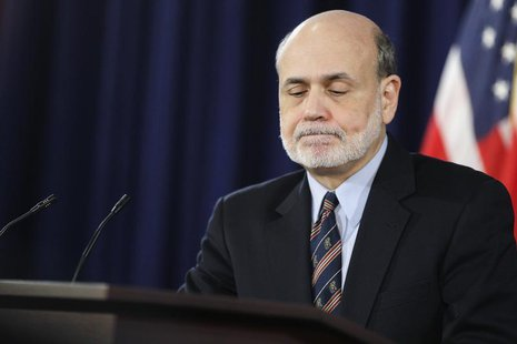 Federal Reserve Board Chairman Ben Bernanke pauses while answering questions at a news conference at the Federal Reserve offices in Washingt