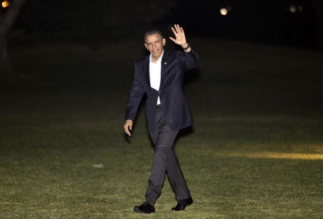 U.S. President Barack Obama waves as he walks on the South Lawn of the White House upon his return to Washington after a trip to Israel, Mar