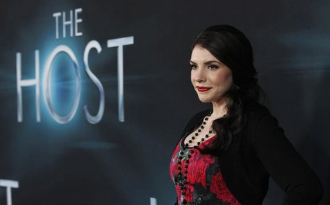 "Author and producer Stephenie Meyer poses at the premiere of ""The Host"" in Hollywood, California March 19, 2013. REUTERS/Mario Anzuoni"