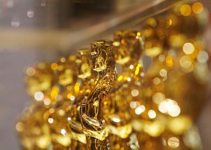 "A line of Oscar statuettes can be seen at a ""Meet The Oscars"" display in Times Square, New York February 15, 2008. REUTERS/Lucas Jackson"