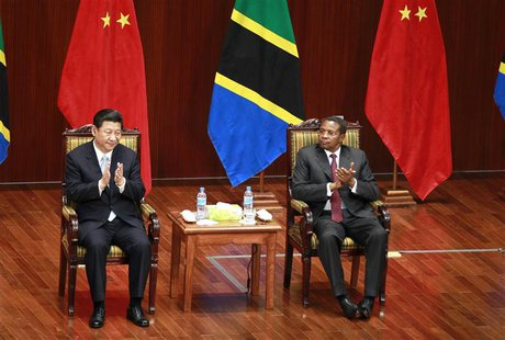 China's President Xi Jinping (L) and his Tanzanian counterpart Jakaya Kikwete (R) attend the opening ceremony of the Julius Nyerere Internat