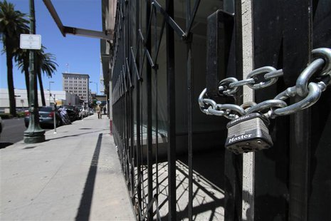 Shuttered and padlocked businesses line Main Street in Stockton, California in this June 27, 2012 file photo. REUTERS/Kevin Bartram/files