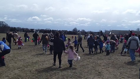 Moments after the big rush began in the playground, children and parents hunt for eggs.