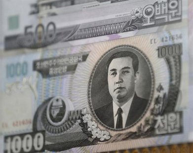 North Korean bank note are seen at a pavilion, just south of the border between the two Koreas, in Paju, north of Seoul, February 15, 2013.