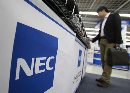 A man looks at NEC Corp's computer displayed at an electronics store in Tokyo October 24, 2012. REUTERS/Yuriko Nakao