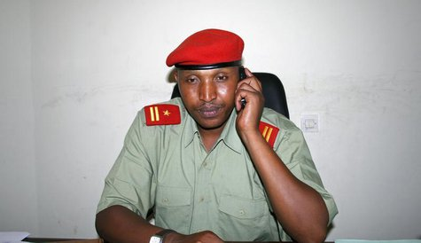 Fugitive Congolese warlord Bosco Ntaganda talks on his mobile phone at his office in Goma, April 4, 2009. REUTERS/Paul Harera