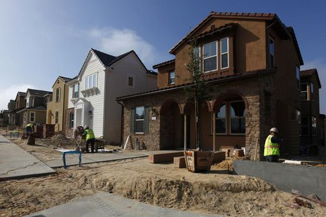 Construction workers put the finishing touches on newly built single family homes in San Diego, California March 25, 2013. REUTERS/Mike Blak