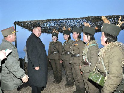 North Korean leader Kim Jong-Un (2nd L) talks with soldiers of the Korean People's Army (KPA) taking part in the landing and anti-landing dr