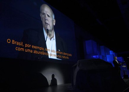 General Motors Chairman and Chief Executive Officer Dan Akerson addresses the Chevrolet Onix World Premiere in Sao Paulo October 21, 2012. R