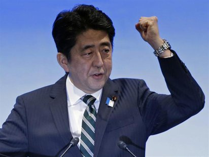 Japan's Prime Minister Shinzo Abe gestures as he delivers his speech during the ruling Liberal Democratic Party (LDP) annual convention in T