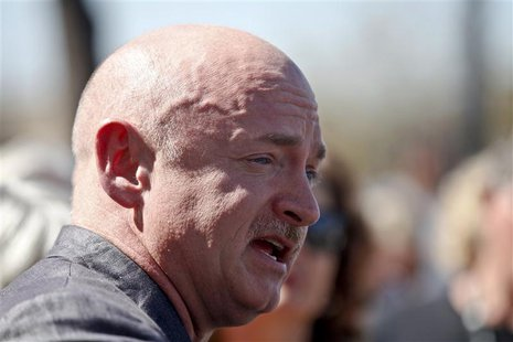 Mark Kelly, husband of former congresswoman Gabrielle Giffords, speaks as they hold a news conference for victims of the January 8, 2011 Tuc