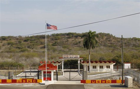 The Northeast gate marks the end of U.S. soil as the road leads into Cuba at Guantanamo Bay U.S. Naval Base, March 8, 2013. Picture taken Ma