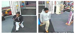 This surveillance photo shows a man and woman suspected of using another person's credit cards at two CVS pharmacies in Brown County, March 12, 2013.