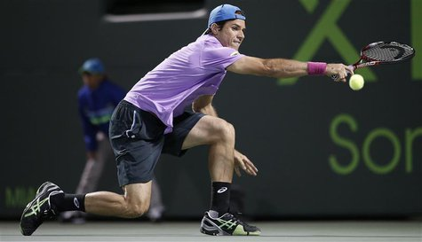 Germany's Tommy Haas stretches for a shot from Serbia's Novak Djokovic in their men's singles fourth round match at the Sony Open tennis tou