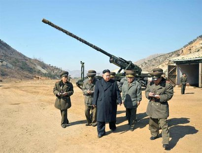 North Korean leader Kim Jong-Un (C) visits a long-range artillery sub-unit of the Korean People's Army Unit 641, whose mission is to strike