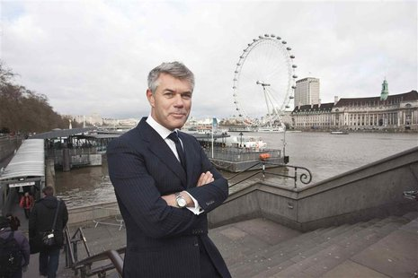 Ola Rollen, the president and chief executive officer of Hexagon, poses by the London Eye in this undated handout photo taken in London and