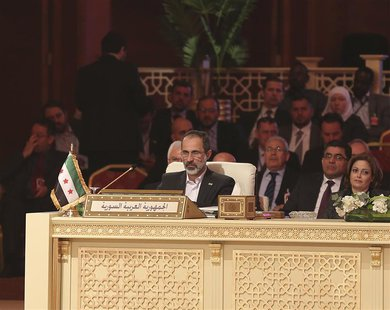 Moaz Alkhatib, head of the Syrian National Coalition, attends the Arab League summit in Doha in this March 26, 2013 handout. REUTERS/Handout