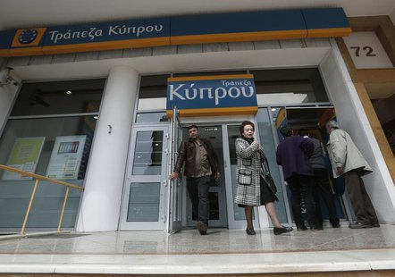 People leave a Bank of Cyprus branch in Athens March 27, 2013. REUTERS/John Kolesidis