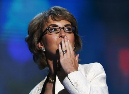 Former Rep. Gabrielle Giffords (D-AZ) blows a kiss after reciting the Pledge of Allegiance during the final session of the Democratic Nation