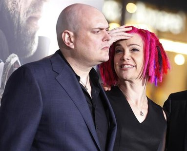 "Andy Wachowski (L) and sibling Lana Wachowski, the screenwriters, producers and directors of the new film ""Cloud Atlas,"" pose as they arrive"