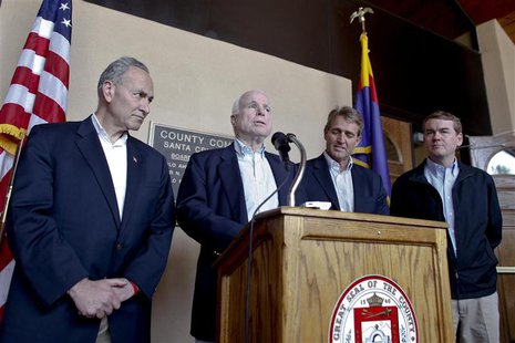 U.S. Senators (L-R) Chuck Schumer (D-NY), John McCain (R-AZ), Jeff Flake (R-AZ) and Michael Bennet (D-CO) hold a news conference following t