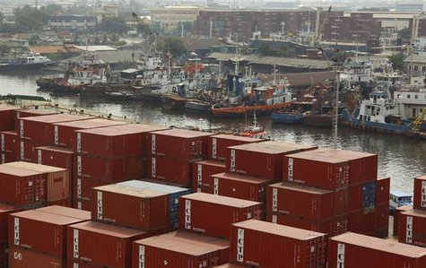 Containers waiting to be loaded onto ships are pictured at Tanjung Priok port in Jakarta December 14, 2012. REUTERS/Yusuf Ahmad
