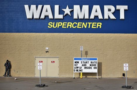 A man stands on a skateboard outside a Wal-Mart store in Williston, North Dakota March 13, 2013. REUTERS/Shannon Stapleton