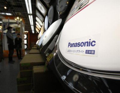 Panasonic's logo on a lamp is seen at an electronic shop in Tokyo February 1, 2013. REUTERS/Yuya Shino