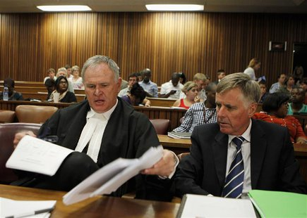 Oscar Pistorius's lawyers Barry Roux (L) and Brian Webber prepare documents before the start of the application to appeal some of his bail c