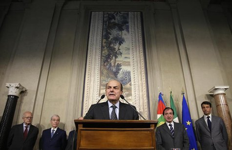 Italy's PD (Democratic Party) leader Pierluigi Bersani (C) speaks during a news conference following a meeting with Italian President Giorgi