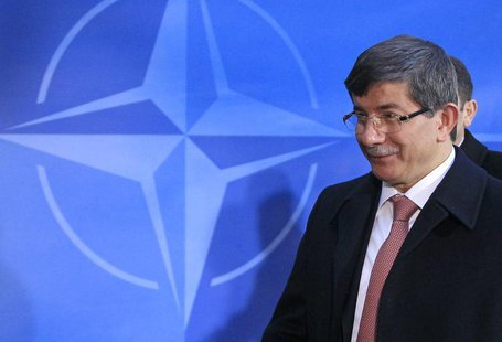 Turkish Foreign Minister Ahmet Davutoglu arrives at a two-day NATO foreign ministers at the Alliance's headquarters in Brussels December 4,