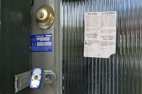 A padlock and foreclosure papers are attached to the front door of a home in the Price Hill neighborhood of Cincinnati, Ohio March 24, 2012.