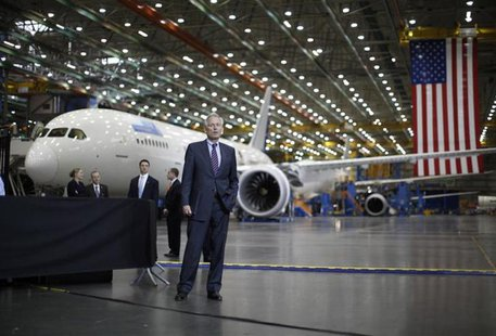 Boeing CEO Jim McNerney waits to be introduced to speak, in front of a Boeing 787 Dreamliner under construction as U.S. President Barack Oba