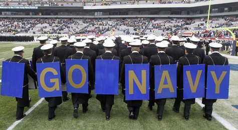 Midshipmen from the United States Naval Academy display placards on their backs as the exit field before the start of the Army versus Navy N