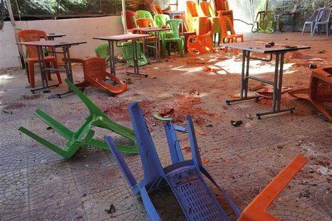 A view shows debris and blood after mortar bombs landed on the canteen of Damascus University's College of Architecture March 28, 2013 in th