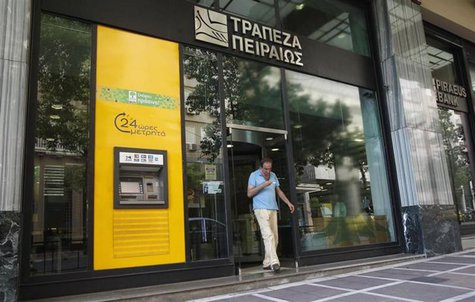 A man walks out of a Piraeus bank branch in central Athens July 16, 2012. REUTERS/John Kolesidis