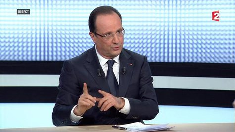 French President Francois Hollande, in this still image taken from video from France 2 television, appears during their prime time news broa