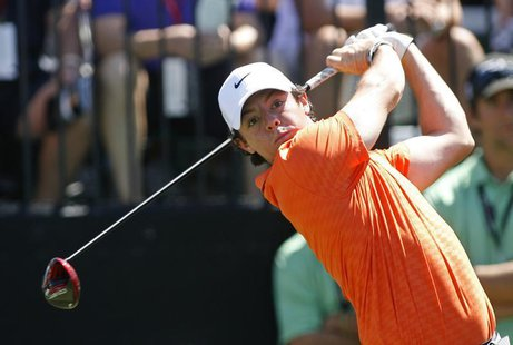 Northern Ireland's Rory McIlroy tees off on the first hole during second round play in the 2013 WGC-Cadillac Championship PGA golf tournamen