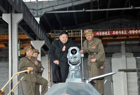 North Korean leader Kim Jong-un (2nd R) looks at the latest combat and technical equipments, made by unit 1501 of the Korean People's Army,